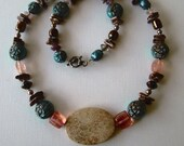 Handmade Beaded Necklace with Fossilized Coral Focal Bead and Pretty Peach and Blue Acrylic and Ceramic Beads
