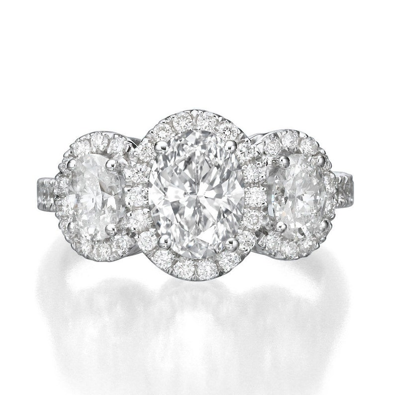 05d93f617569d 1 1/2 Carat Oval Halo Diamonds 3 Stone Engagement Ring