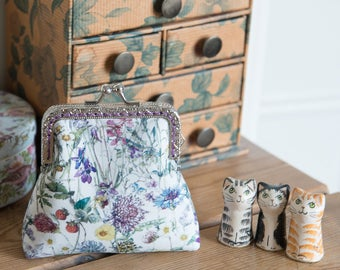 Coin purse made with wild flower print  Liberty Tana Lawn outer, purple cotton interior, and a hand stitched silver colour metal frame