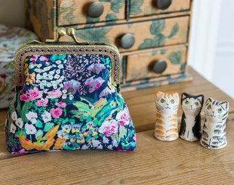 Coin purse made with Liberty Tana Lawn in the print: 'Painter's Meadow', a deep purple cotton lining, and hand stitched bronze metal frame