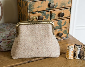 Larger size coin purse in oatmeal Harris Tweed with an alpine themed Liberty lawn lining and a light bronze coloured metal frame