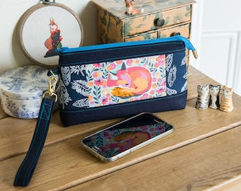 Large purse or small clutch with detachable wristlet in a really useful size, featuring a sleeping fox in blues, pinks and oranges
