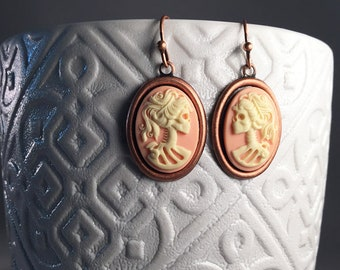 Vintage ivory and pink Lolita skeleton cameo earrings. Vintage copper Gothic pink skeleton earrings.  Vintage Gothic skeleton cameo earrings