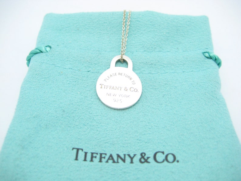 6dd2a7138 Please Return To Tiffany & Co. Sterling Silver Round Tag | Etsy