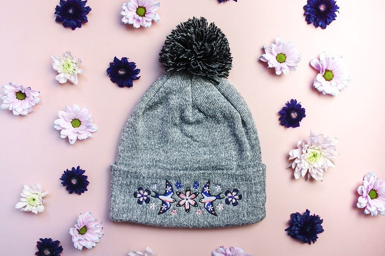 fbaf5d134cb7c Floral Flight Swallow Embroidered Beanie    Grey Birds Wooly