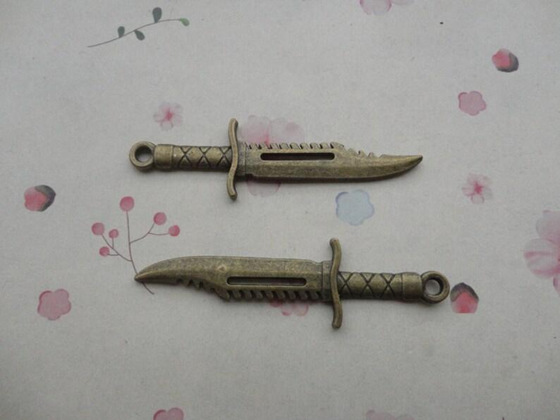 30pcs antique bronze metal dagger charm metal dagger pendant 67X19mm CP658