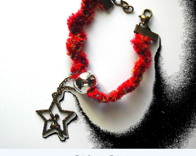 Red: Red fabric bracelet, bronze angel and star charm, adjustable carabiner