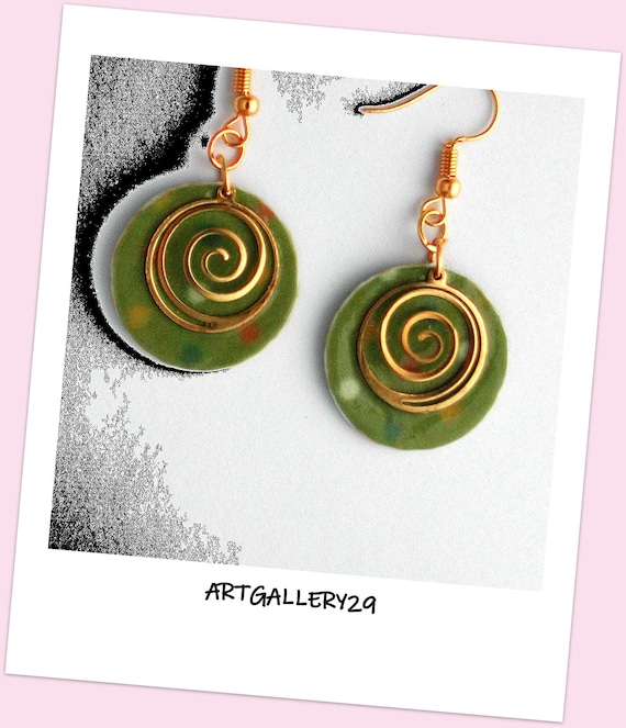 Spiral collection: Golden spiral earrings on a khaki green circle with multicolored polka dots, golden hooks for pierced ears