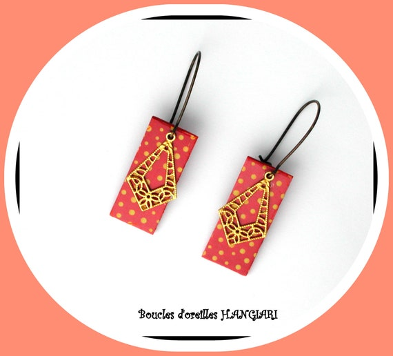 Gilded polka dot collection: Brilliant red gold polka dot earrings, golden filigree, golden polka dot rectangle on brick background, elegant