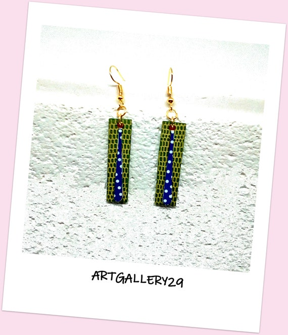 Blue with polka dots-- Blue earrings with white polka dots on long thin drop superimposed on a green pendant rectangle in faux leather lizard