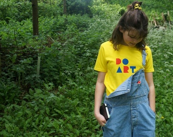 DO ART organic t-shirt for kids in yellow or navy