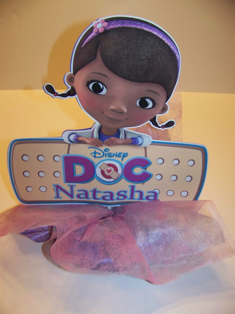 Doc McStuffins Centerpiece Customized on styrofoam base covered with pink foil or gossamer Single sided