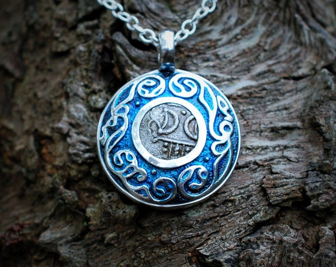 Moon talisman necklace. Silver pendant with a genuine 2000 year old Celtic coin featuring a moons motive similar to the goddess symbol.