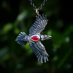 Ruby Raven necklace, Solid silver & gold raven with black finish and a real ruby. Double sided pendant and chain.
