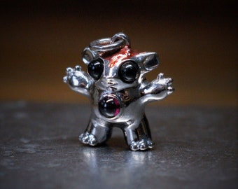 Bright Creature No.8, Unique solid silver creature set with a garnet and onyx eyes, NFT certificate of ownership, red patina © Argent Aqua