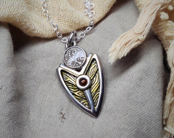 Shield necklace with genuine 2000 year old Celtic coin. Sterling silver with green patina and a natural gemstone. Silver chain © Argent Aqua