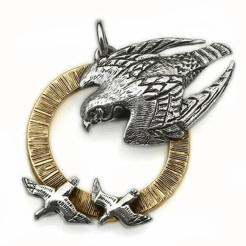 bird of prey animal totem jewelry as seen on TV. Peregrine Falcon necklace solid gold and silver raptor pendant