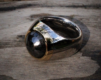 Diamond ring set with a very large 12.35ct rose-cut black diamond. Would fit a UK finger size S to T, US size 9.5 © Argent Aqua