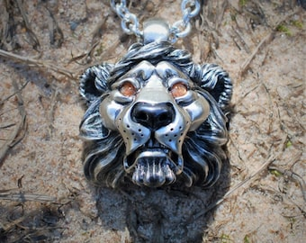 Noble Lion Pendant, very heavy, solid sterling silver lion's head and chain set with sunstone eyes. © Argent Aqua