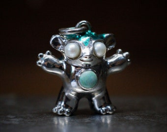 Bright Creature No.9 Unique solid silver creature set with turquoise and pearls, NFT certificate of ownership, green patina © Argent Aqua