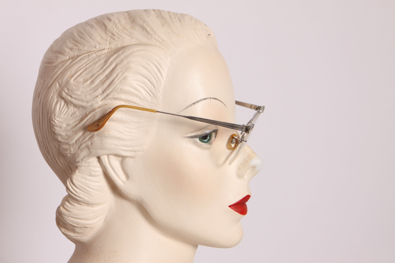 1950s lente flotante plata aluminio puntiagudo gato gafas de