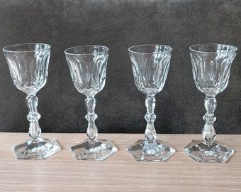 Antique set of four hand cut crystal shot glasses.