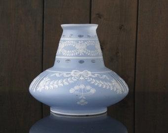 Vase light blue glass with white garland decor.