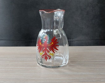 Oud schenkkannetje in optisch geblazen glas.