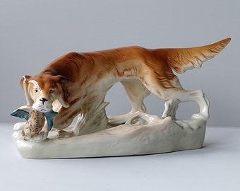Royal Dux porcelain sculpture of an Irish setter hunting scene.