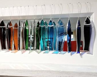 Fish mirror. 11 handmade glass Fish on a white wood framed mirror.