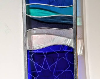 Hand made glass panel with star etchings.