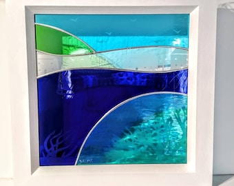 Hand made glass panel depicting Seaweed, cottages, boats and seagulls.