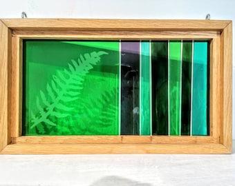 Etched fern leaf glass panel in solid oak frame.