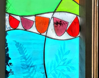 Abstract red boats glass panel.