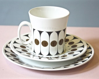A bone china trio made by Hostess Tableware, designed by John Russell.