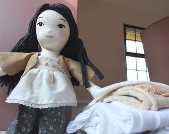 Handmade, cotton, heirloom, asian doll with embroidered face and black hair.