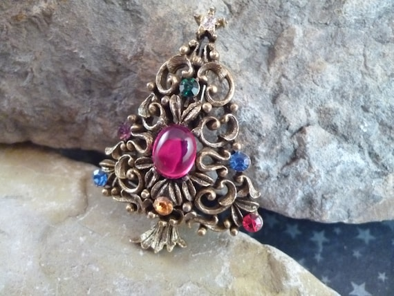 J.J. (Jonette) Signed Antiqued Brass Collectible Christmas Tree Pin with Center Red Stone Cabochon Book Piece