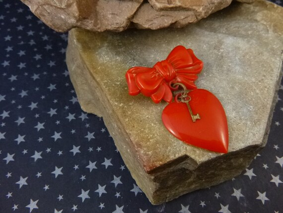 1950s Celluloid Plastic Red Valentine Heart with Key Dangling from Bow | Vintage Mid Century Heart Pin | Book Piece