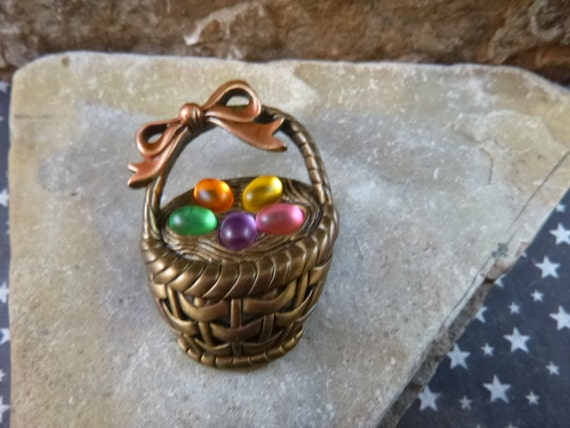 Easter Basket J.J. Antiqued Brass Vintage Brooch with Bright Yellow Pink Purple Green and Orange Acrylic Eggs Topped with a Peach Bow