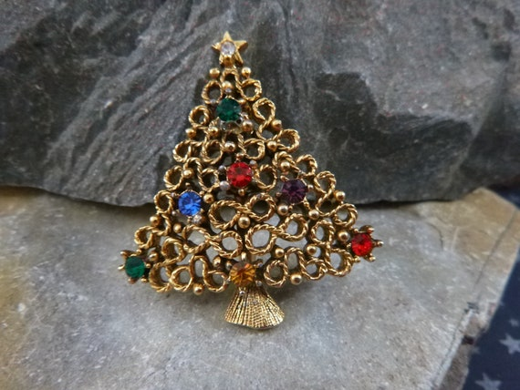 J.J. Vintage Christmas Tree Pin with Scroll Design and Multi-colored Stones   1970s Book Piece