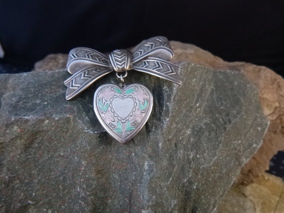 Romantic Pink and Green Floral Themed Vintage Heart Locket Dangling from Bow   Victorian Revival Sweetheart Pin   Two Picture Locket Brooch