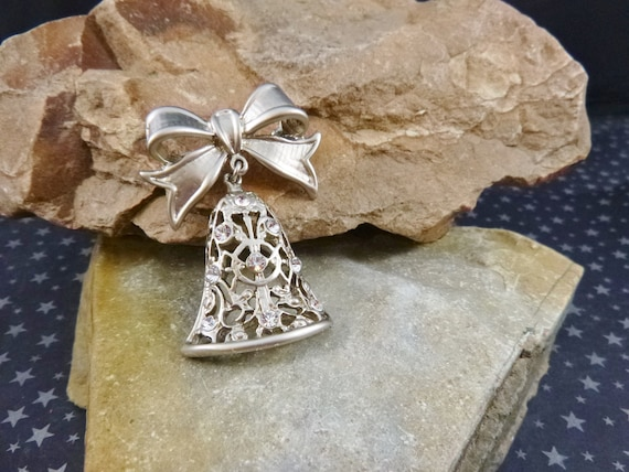 Festive Holiday Silvered Vintage Bell on Bow Pin | Pot Metal Mid Century Christmas Holiday or Wedding Bell Brooch with Clear Rhinestones