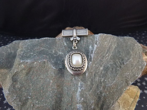 Timeless Classic Vintage Locket Dangling from Bar Brooch | Oval Two Picture Silver Tone Locket with Pearlized Center