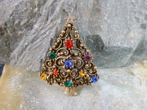 Vintage J.J. Collectible Christmas Tree Pin with Scroll Design and Multi-colored Stones Book Piece
