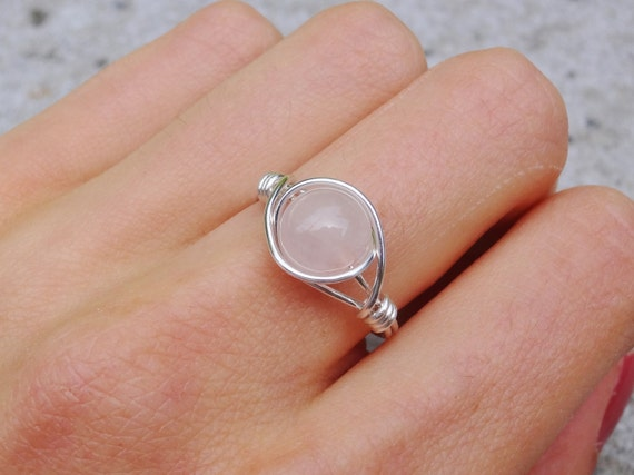 Silver wire ring with pink gem