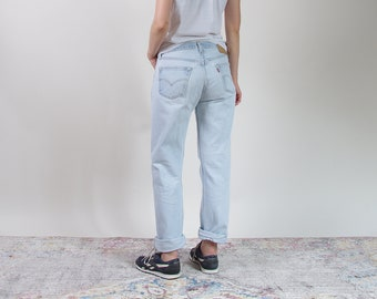 80s Levi's 501 distressed light wash boyfriend jeans made in USA