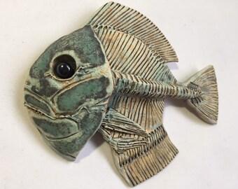 Small green skeletal ceramic fish, left facing, ceramic wall art. Fish wall hung sculpture, Home decor, handmade, one off.