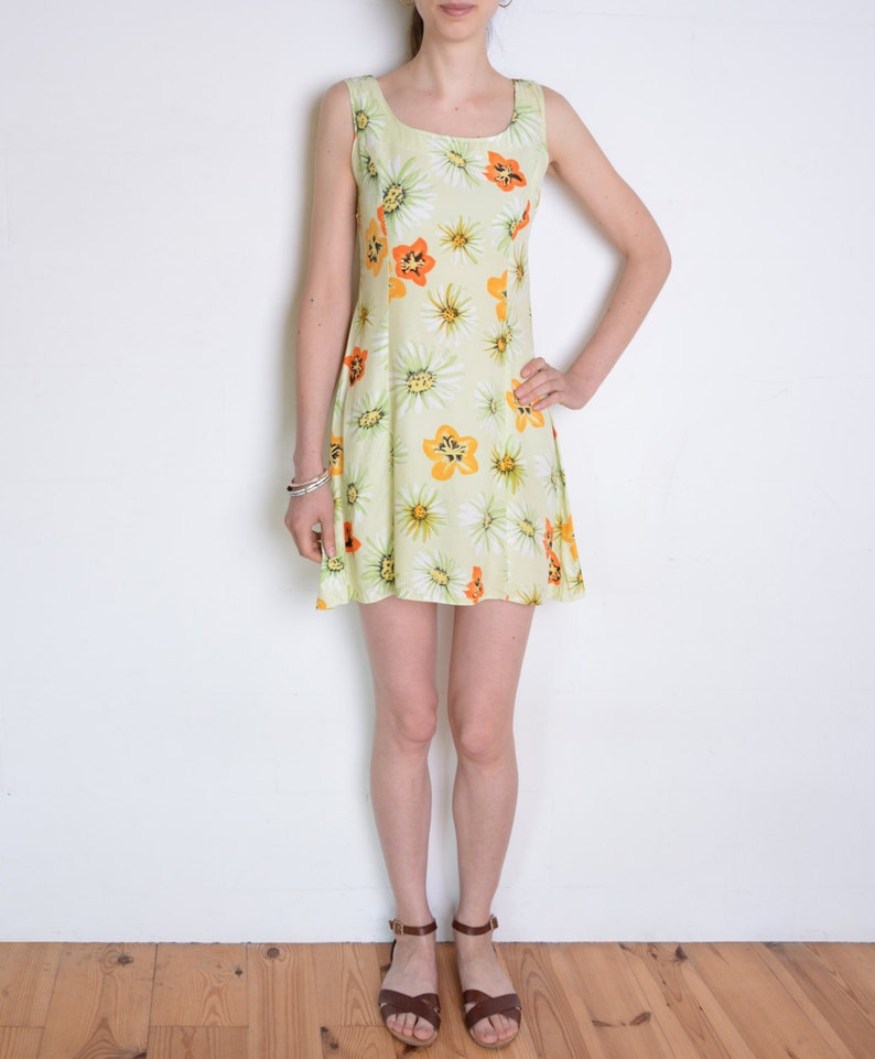 cb6f3a0de66 90 s floral sleeveless mini dress chamomille flowers