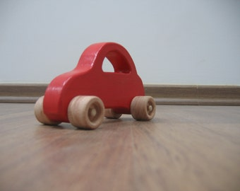 Red wooden toy car for toddlers and children