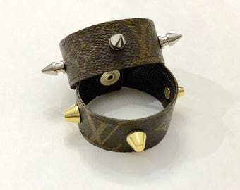 Authentic re-purposed Louis Vuitton cuff bracelet with your choice of silver spikes or gold bucket studs